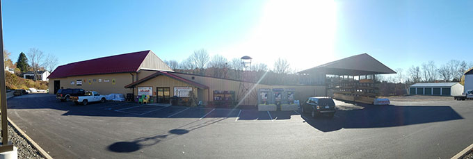 Panoramic photo of front of building with bright blue sun